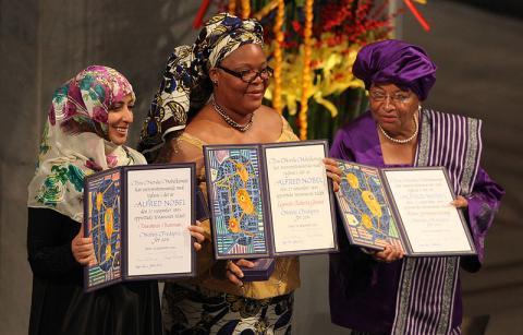 Tawakkul Karman, Leymah Gbowee, Ellen Johnson Sireleaf accept the Nobel Peace Prize.
