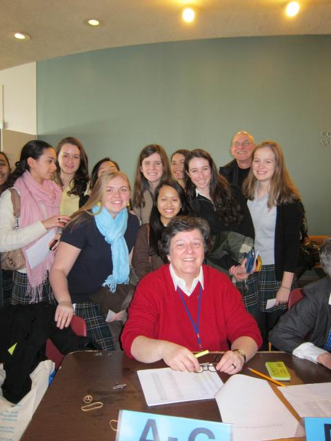Photo of the high school girls attending UN World Interfaith Harmony week with Cecile Meijer, rscj
